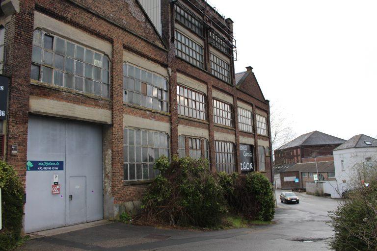 Wavre, anciens ateliers de Raedt. D'une tour-hôtel à un bâtiment mixte mêlant ancien et contemporain.